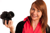 Young woman photographer with camera in her hand — Foto Stock