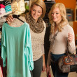 Womans shopping - Two girls in a clothes shop choosing garment — Stockfoto