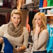 Two girls shocked by a price of clothes in a shop — Foto Stock