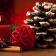 Pine cone and candle cristmas decoration — Stock Photo
