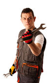 Angry mechanic threats with wrench — Foto de Stock