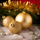 Golden christmas balls on a table — Stock Photo