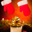 Christmas gifts arranged on a table with spruce branches and lig — Stock Photo #34423275