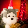 Plush bear in golden present box christmas ornaments with lights — Stock Photo