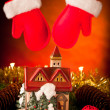 Decorative house christmas ornament with red gloves hanging in b — Stock Photo