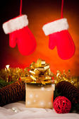 Christmas gifts arranged on a table with spruce branches and lig — Stock Photo