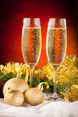 Two glasses of sparkling wine on christmas and new year decorati — Stock Photo