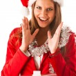 Beautiful young woman in santa claus dress standing isolated ove — Photo