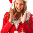 Beautiful young woman in santa claus dress standing isolated ove — Foto de Stock