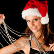 Beautiful young woman in red santa dress isolated over black bac — Stock Photo