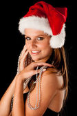 Beautiful young woman in red santa dress isolated over black bac — Stockfoto