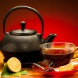A cup of black tea with teapot in the background — Stock Photo #35841077