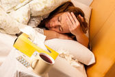 Woman with flu resting in bed — Stock Photo