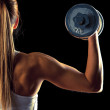 Fitness girl - attractive young woman working out with dumbbells — Stock Photo #39178629