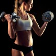 Fitness girl - attractive young woman working out with dumbbells — Stock Photo #39178297