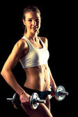 Fitness girl - attractive young woman working out with dumbbells — Foto de Stock