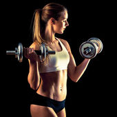 Fitness girl - attractive young woman working out with dumbbells — Stock Photo