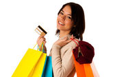 Attractive asian caucasian woman with shopping bags and credit c — Stock Photo