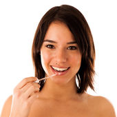 Beautiful young asian caucasian girl applying lipgloss on her l — Stock Photo