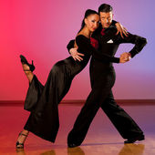 Professional ballroom dance couple preform an exhibition dance  — Stock Photo
