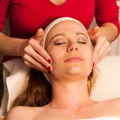 Woman having face skin treatment in wellness — Stock Photo