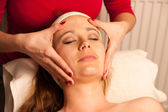 Woman having face skin treatment in wellness — ストック写真