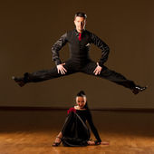 Professional ballroom dance couple preform an exhibition dance  — Stock Photo