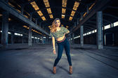 Hip hop dancer in an abandoned industrial hall  — Foto Stock