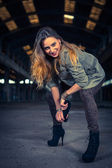 Hip hop dancer in an abandoned industrial hall — Stock Photo