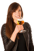 Woman hilding glass of beer in her hands — Stock Photo