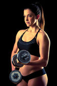 Fitness girl - attractive young woman working out with dumbbells — Stockfoto