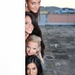 Women appearing behind the wall — Stock Photo