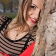 Beautiful woman in autumnal park — Stock Photo