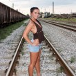 Woman on railway tracks — Stock Photo