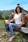 The beautiful woman on a motorcycle — Stockfoto