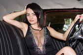 Sensual woman sitting retro car — 图库照片