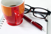 Notebook glasses coffee cup — Stockfoto