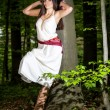 Young woman in a forest enjoying — Stock Photo #49854869