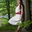 Young woman in a forest enjoying — Stock Photo #49855495
