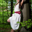 Young woman in a forest enjoying — Stock Photo #49855895