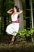 Young woman in a forest enjoying — Stock Photo
