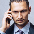 Young business man using cell phone — Stock Photo