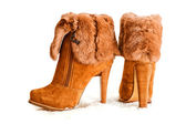 Brown high heels ankle boots with fur — Stock Photo