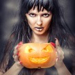 Witch holding pumpkin — 图库照片