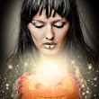Woman witch making magic to pumpkin — Stock fotografie