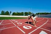 Man tourist kneeling on a starting grid — Stock Photo