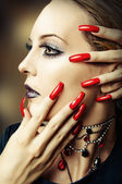 Fashion make up and long red nails — Stock Photo