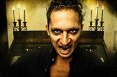 Male vampire with evil eyes — Stock Photo