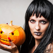 Woman witch with pumpkin — Stock Photo