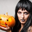 Woman witch with pumpkin — Stok fotoğraf